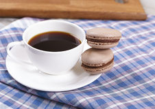 Cup of coffee with macaroons. Morning black coffee in a cup, with almond cookies Royalty Free Stock Image