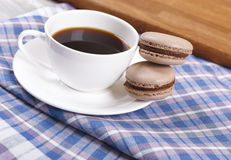 Cup of coffee with macaroons. Morning black coffee in a cup, with almond cookies Stock Photography