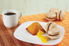 Cup of coffee, macaroons and caramel pudding Royalty Free Stock Image