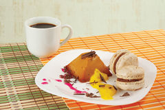 Cup of coffee, macaroons and caramel pudding Royalty Free Stock Images