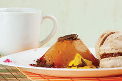 Cup of coffee, macaroons and caramel pudding Stock Photo