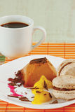 Cup of coffee, macaroons and caramel pudding Royalty Free Stock Photo