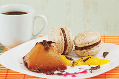 Cup of coffee, macaroons and caramel pudding Stock Photography