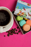 Cup of coffee with macaroons and coffee beans Stock Photography