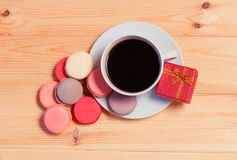 Cup of coffee, macaroons and gift box Royalty Free Stock Photo