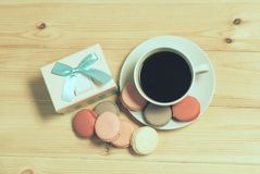 Cup of coffee, macaroons and gift box Royalty Free Stock Photos