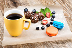 Cup of coffee with macaroons. On wooden background Royalty Free Stock Photo