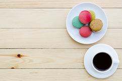 Cup of coffee and macaroons. On wooden table, top view Royalty Free Stock Photography