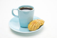 Cup of coffee and madeleines cookies on a white background Stock Photography
