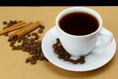 Cup of coffee. Magic aromas of coffee with cinnamon Stock Photos