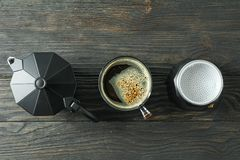 Cup of coffee and coffee maker on wooden table, space for text. And top view stock photos