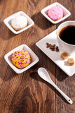 Cup of coffee  and marshmallow biscuits with icing colored granu Stock Photo