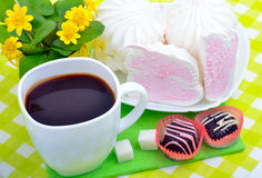 Cup of coffee with marshmallows and chocolate candies Stock Photography