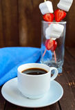 A cup of coffee and marshmallows with fresh strawberries on skewers Royalty Free Stock Images
