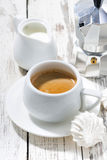 Cup of coffee with marshmallows on white table Stock Images