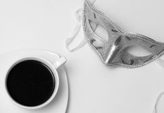 Cup of coffee and a mask Royalty Free Stock Image