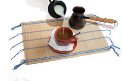 Cup with coffee on mat Royalty Free Stock Photo