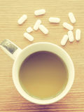 Cup of coffee with medicine pill Stock Image