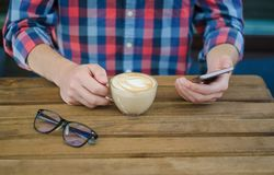 A Cup of coffee in men`s hands stock photos