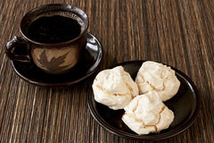 Cup of coffee with meringue cookies and coffee beans Stock Images