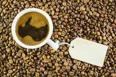 Cup of coffee with message. White cup of coffee on coffee beams with message Stock Images
