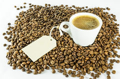 Cup of coffee with message. White cup of coffee on coffee beams with message Stock Photography