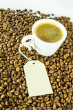 Cup of coffee with message. White cup of coffee on coffee beams with message Royalty Free Stock Images