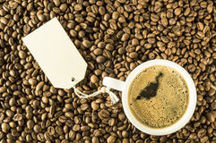Cup of coffee with message. White cup of coffee on coffee beams with message Royalty Free Stock Image