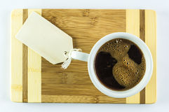 Cup of coffee with message. White cup of coffee on a table with room for text Stock Photo