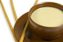 Cup of coffee with milk. And two grain sticks. On a white background Royalty Free Stock Photos