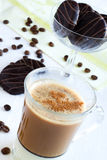 Cup of coffee with milk. Coffee with milk and cinnamon, and chocolate cookies Stock Photos
