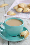 Cup of coffee with milk and apple pies on wooden background Stock Image