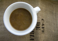 Cup of coffee with milk on a background of burlap stock images