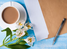Cup of coffee with milk, blank paper in the envelope, pen and al Royalty Free Stock Photo