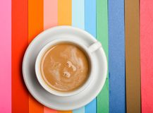 Cup of coffee with milk or cappuccino beverage on colorful as rainbow background. Dose of energy concept. Drink with. Caffeine or cocoa with milk. Coffee on Royalty Free Stock Photography