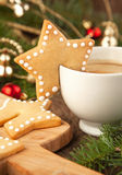 Cup of coffee with milk and christmas sugar cookies Stock Image