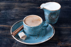 Cup of coffee with milk, cinnamon and sugar Stock Photo