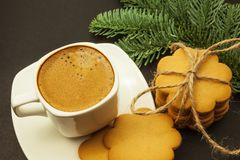 Cup of coffee with milk crema and ginger cookies, Christmas morning, close-up stock photo
