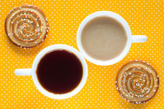 Cup of coffee with milk. A cup of tea. Two round cookies. With sesame seeds. Top view stock photo