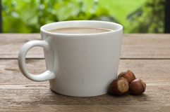 Cup of coffee with milk and hazelnut Royalty Free Stock Photography