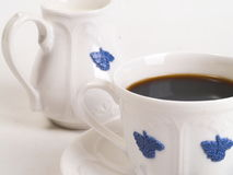 Cup of coffee and milk jug Stock Photos