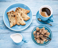 Cup of coffee, milk jug, cane sugar cubes and fruit-cake. Royalty Free Stock Images