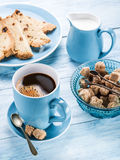 Cup of coffee, milk jug, cane sugar cubes and fruit-cake. Stock Photo
