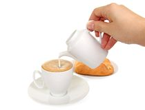 Cup of coffee, milk jug and fresh bakery Stock Photo