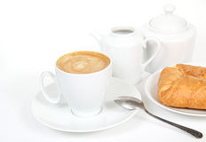 Cup of coffee, milk jug and fresh bakery Stock Photography