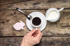 Cup of Coffee with Milk Jug on Wood Background. Stock Photography