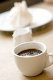 Cup of coffee, milk and meringue Stock Image