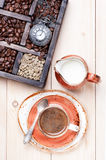 Cup coffee with milk and old box with coffee beans Stock Images