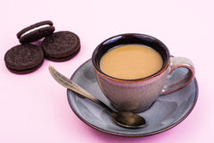 Cup of coffee with milk on pastel background Stock Photo