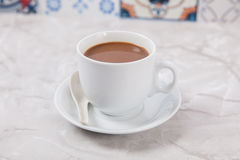 Cup of Coffee. With milk on a plate Stock Photography